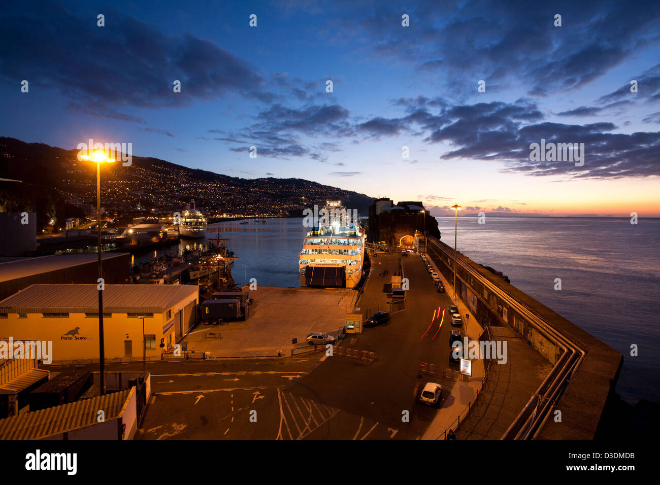 Funchal harbour at dawn with the Porto Santo ferry just departing. - Stock Image