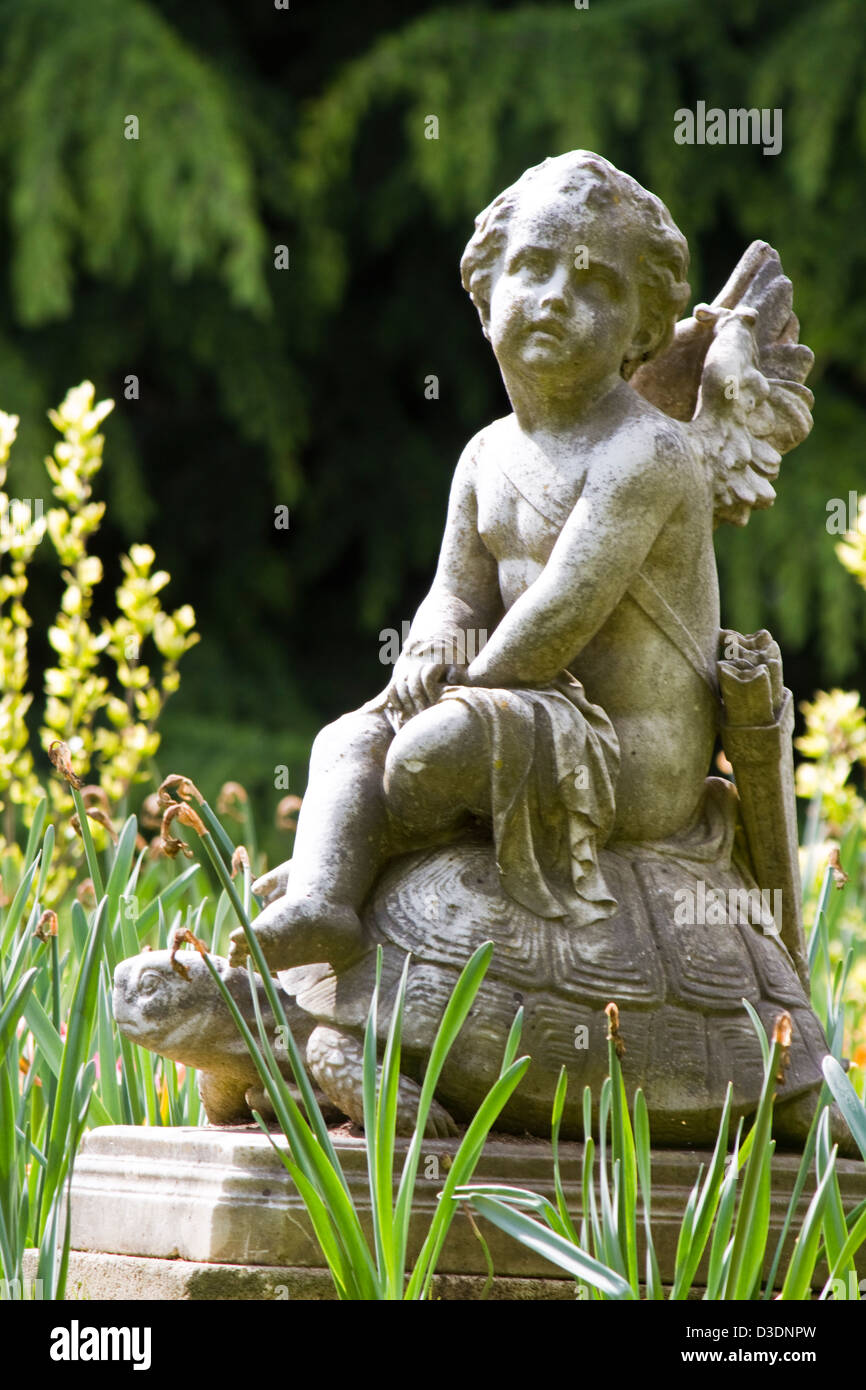 View of an beautiful child angel statue on a urban park. - Stock Image