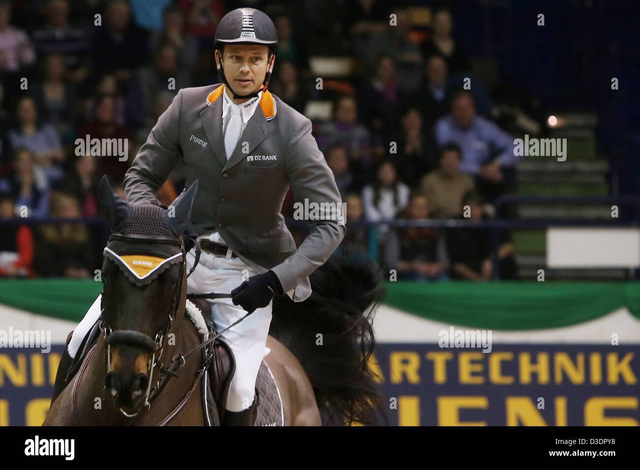 "German showjumper Marco Kutscher jumps on his horse ""Cornet's Cristallo"" during the internation showjumping Grand Stock Photo"