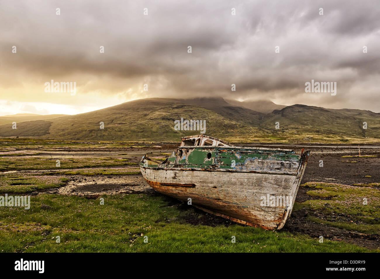 evening storm & abandoned boat, mull, scotland - Stock Image
