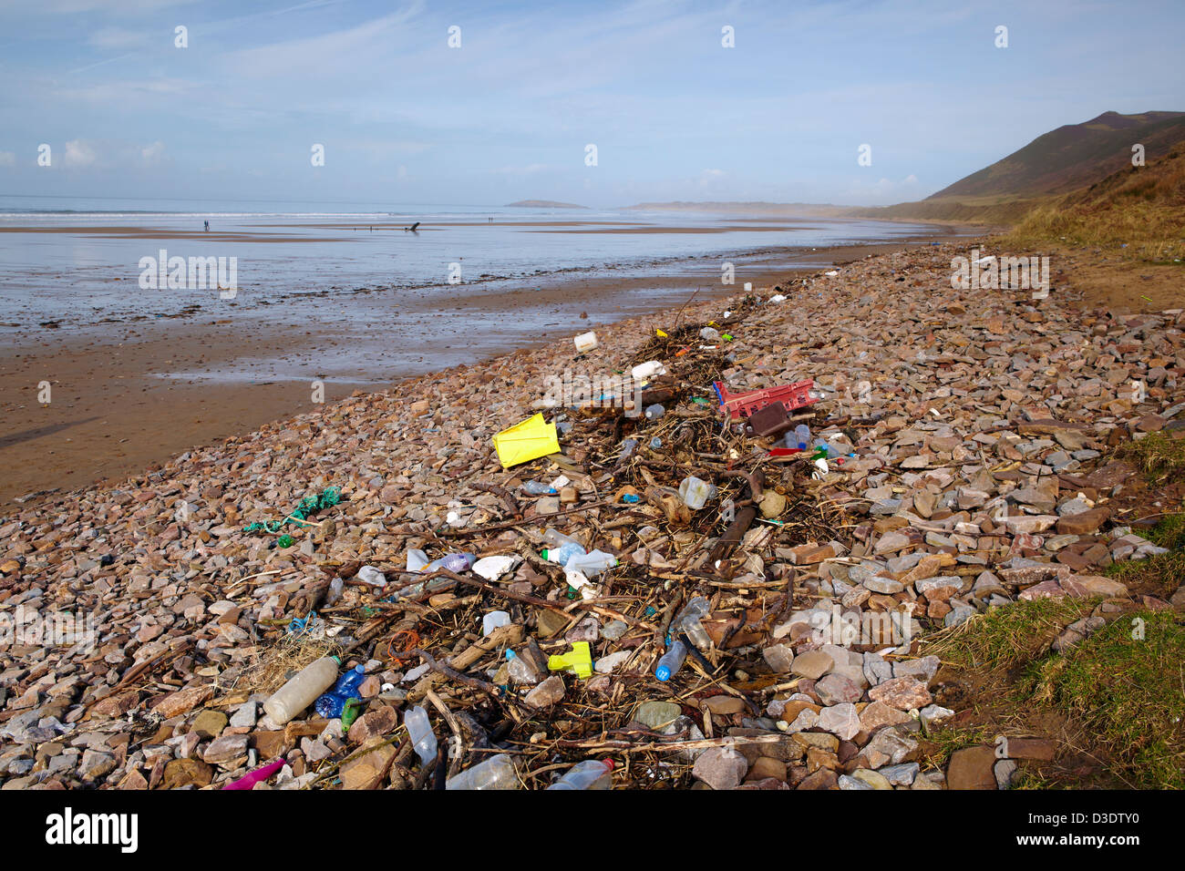 Rubbish along the high tide mark, Rhossili beach, Gower, Swansea, Wales. - Stock Image