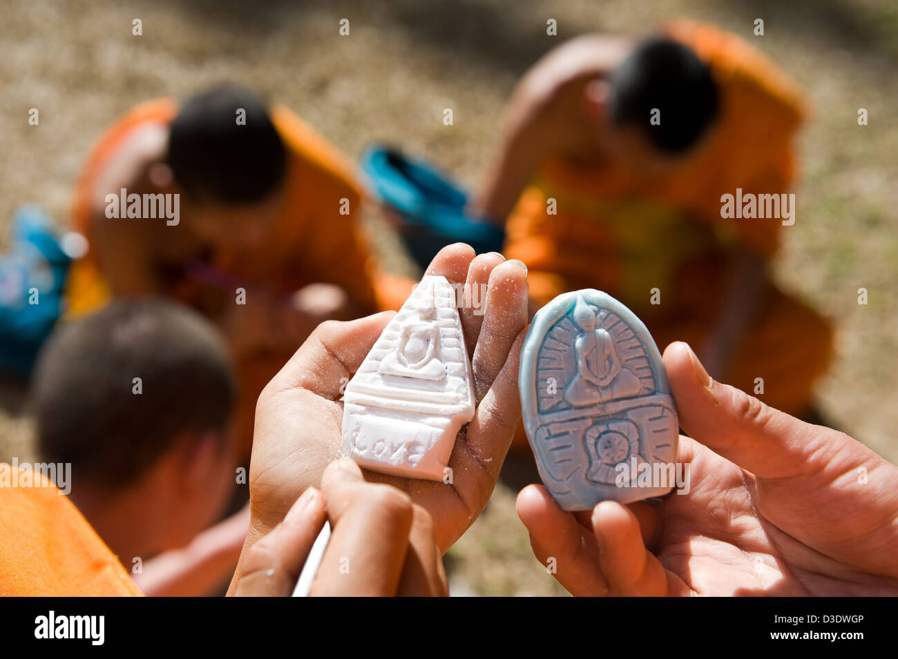 Fang, Thailand, school novices engrave Buddha statues on soaps - Stock Image