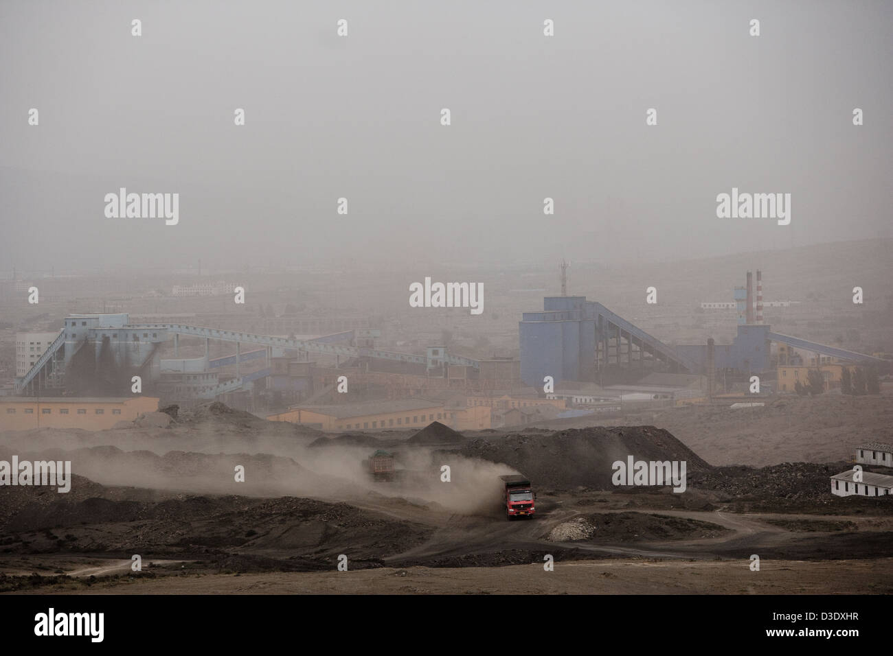 WUDA COAL FIELD, WU HAI, INNER MONGOLIA, CHINA - AUGUST 2007:  A coal truck makes his way over dusty dirt roads - Stock Image