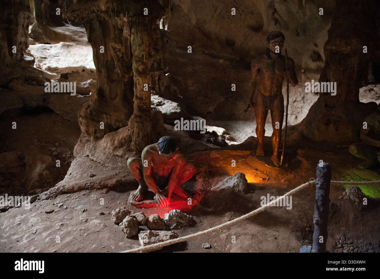Krabi, Thailand, figures in Kanab Nam cave represent the colonization - Stock Image