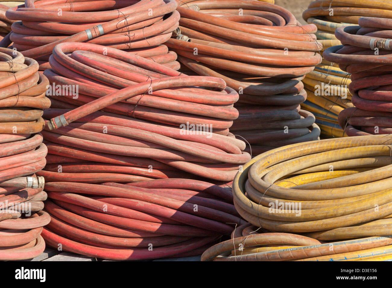 water hoses drilling pump pumping - Stock Image