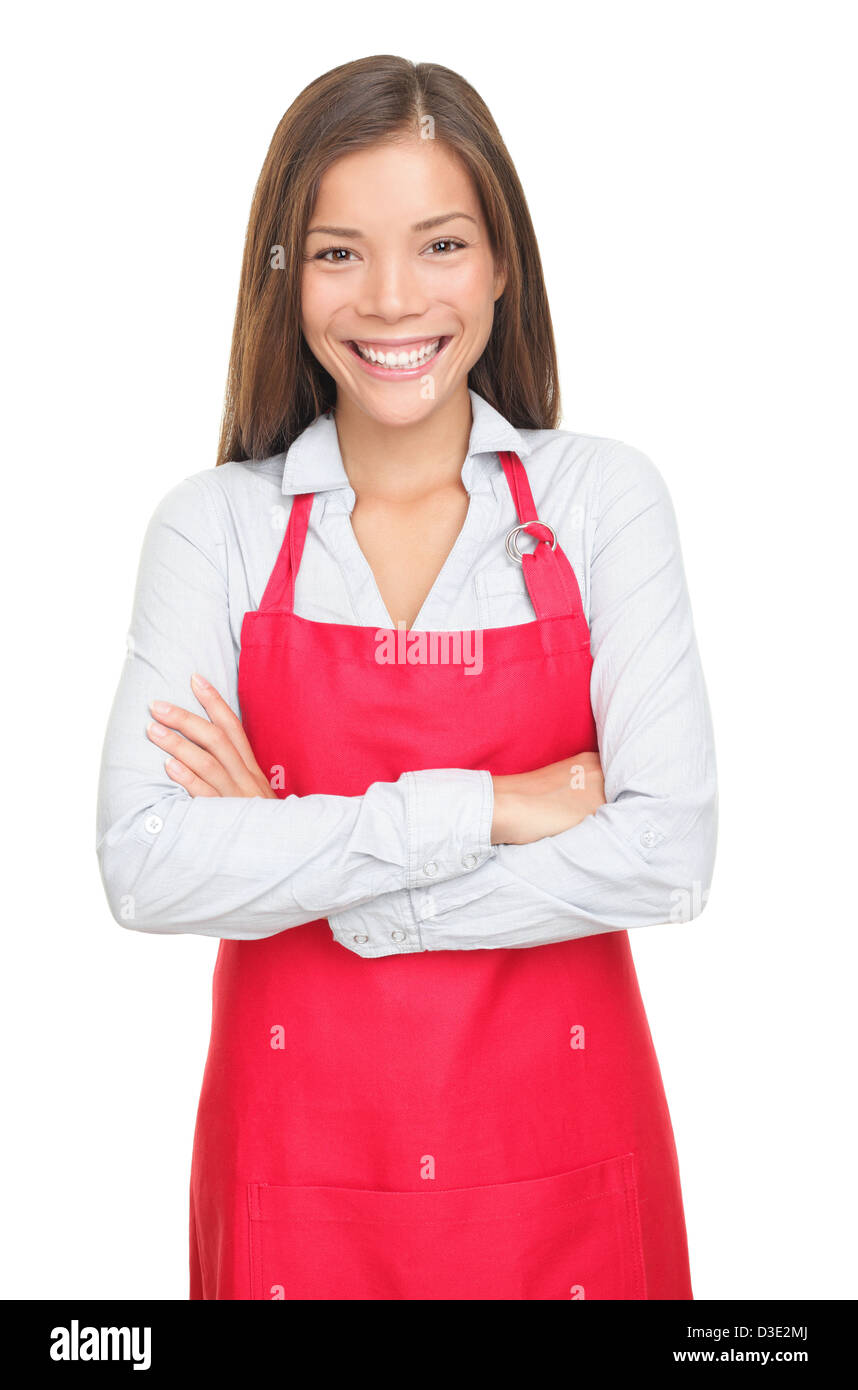 Portrait of happy beautiful mixed race female sales clerk or small shop owner with arms crossed isolated on white - Stock Image