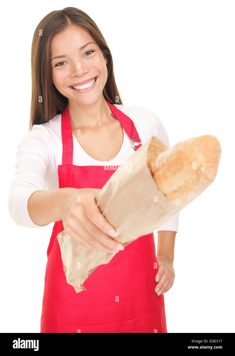 Portrait of beautiful mixed race Caucasian / Asian woman sales clerk giving bread to customer isolated on white - Stock Image