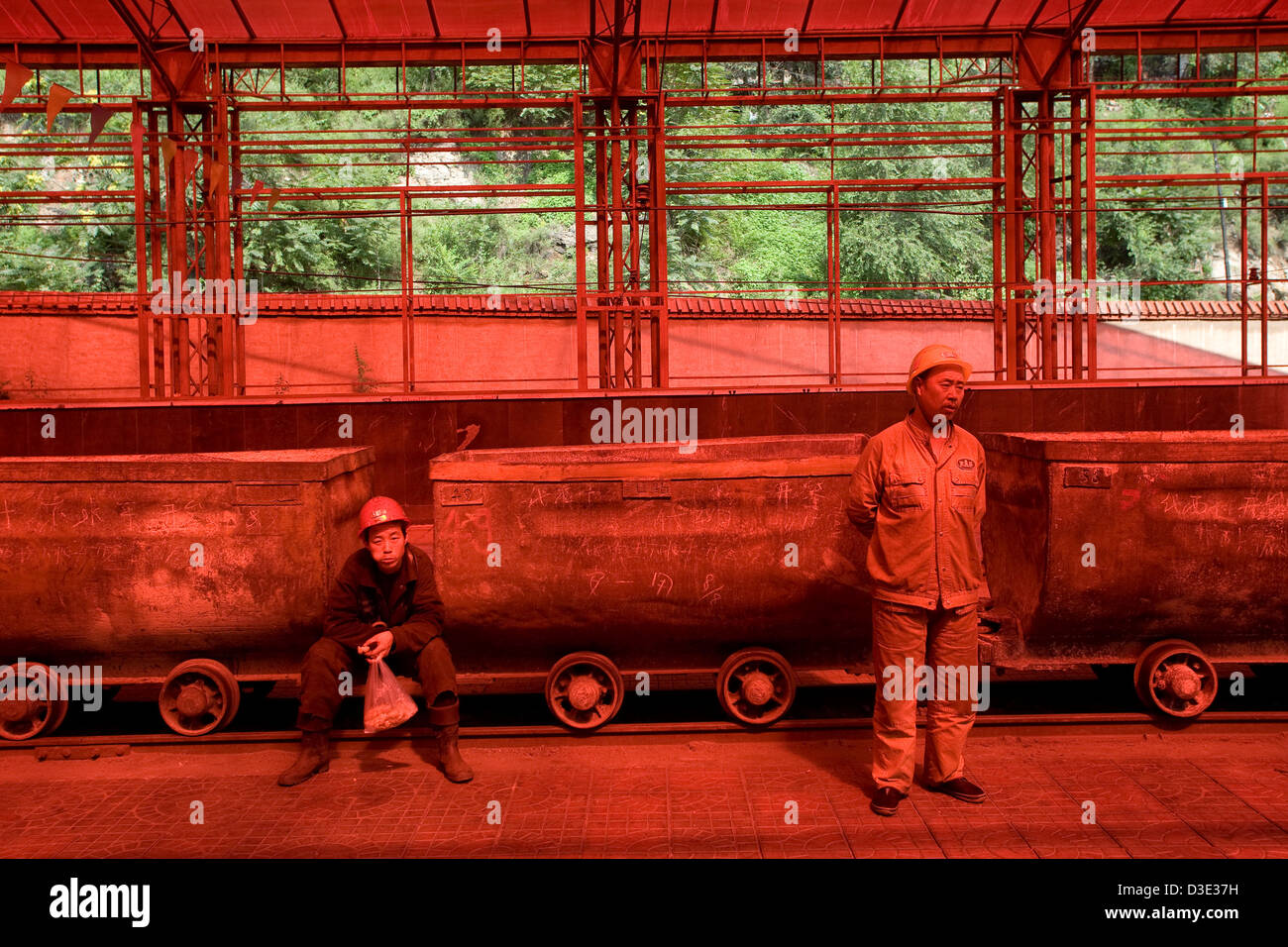 XIMING COAL MINE, TAIYUAN, CHINA - AUGUST 2007: Miners wait for the narrow guage electric trains that will take Stock Photo