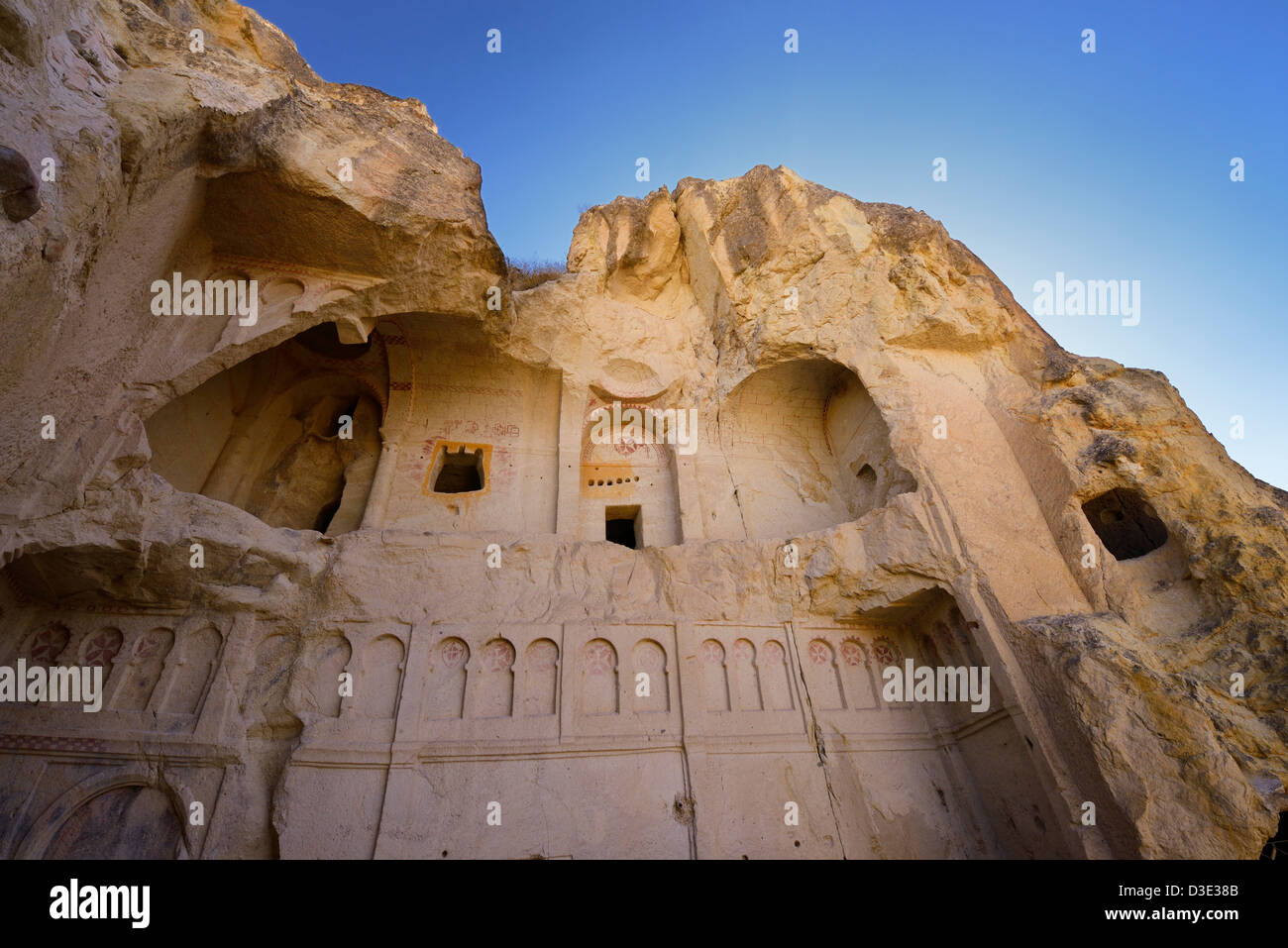 Crumbled exterior of the Dark Church christian monastery cave at the Goreme Valley Open Air Museum Cappadocia Turkey - Stock Image