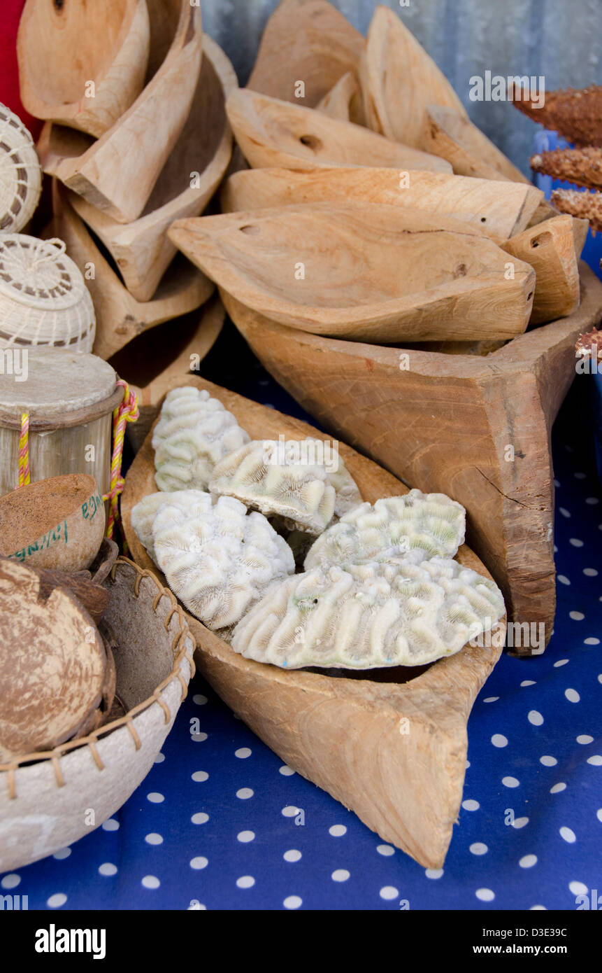 Guatemala, Livingston. Typical souvenir stand with hand woven baskets, hand carve wooden canoes & sea coral. - Stock Image