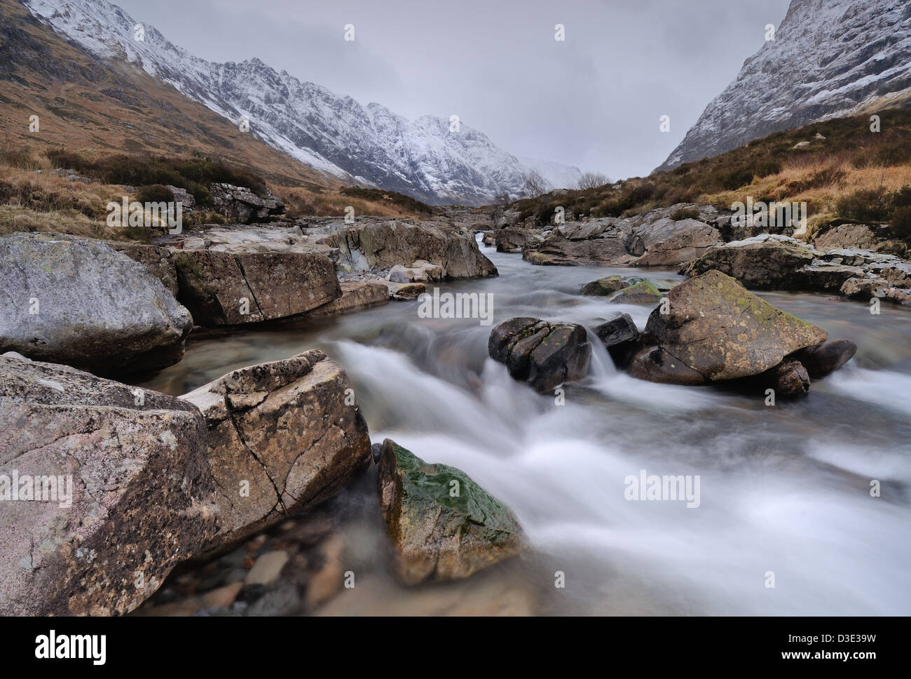 River Coe, Glencoe, with the snow covered ridge of the Aonach Eagach in the background - Stock Image