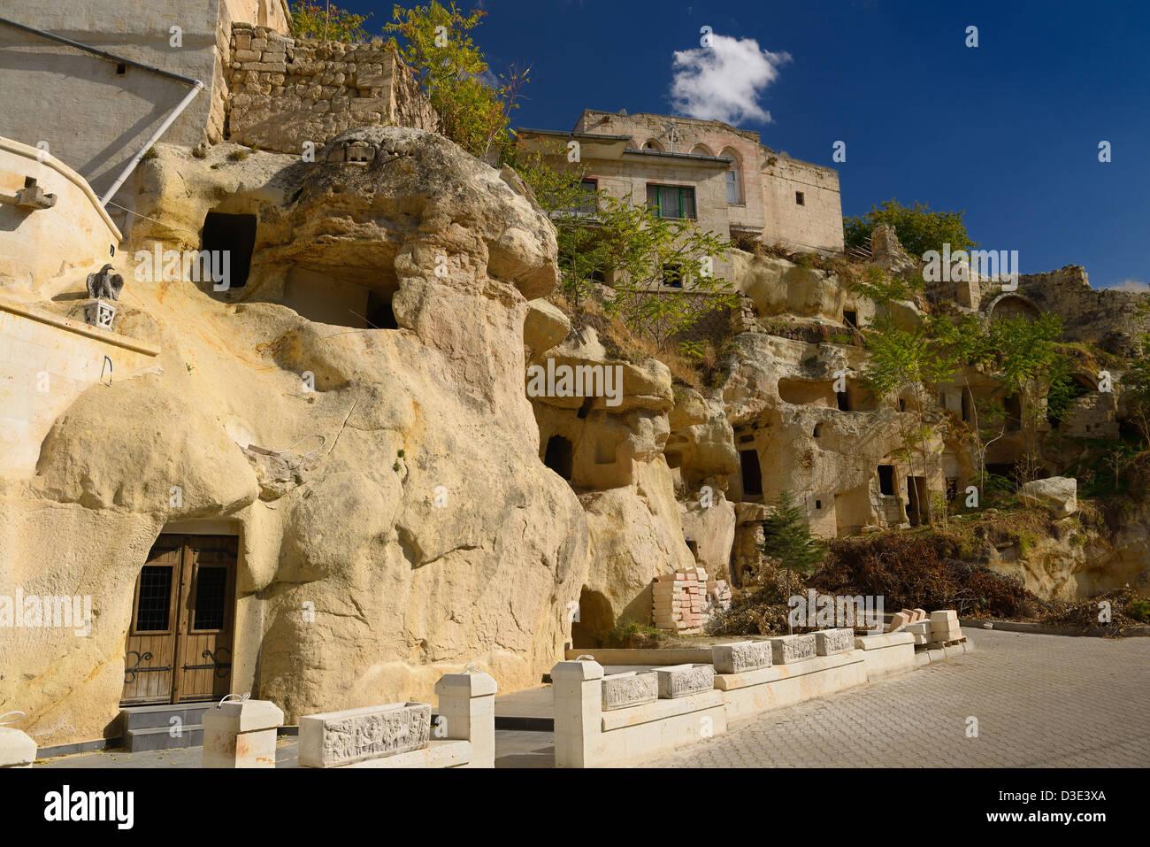Construction development on volcanic tuff cave houses at Mustafapasa Nevsehir Cappadocia Turkey - Stock Image