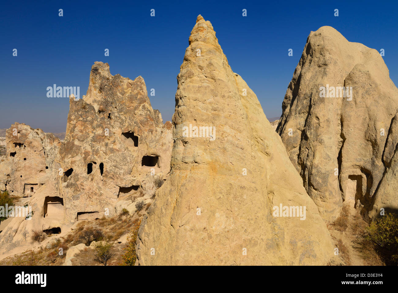 Volcanic Tuff Fairy Chimney caves at Goreme Valley Open Air Museum Turkey with Nunnery and Buckle Church Cappadocia - Stock Image