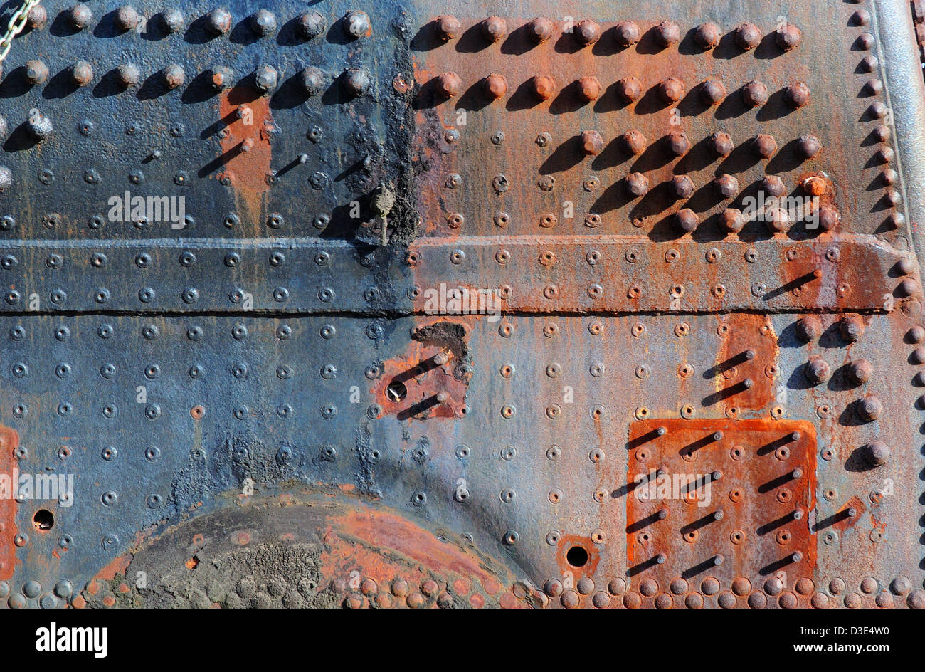 side of an antique railroad steam locomotive - Stock Image