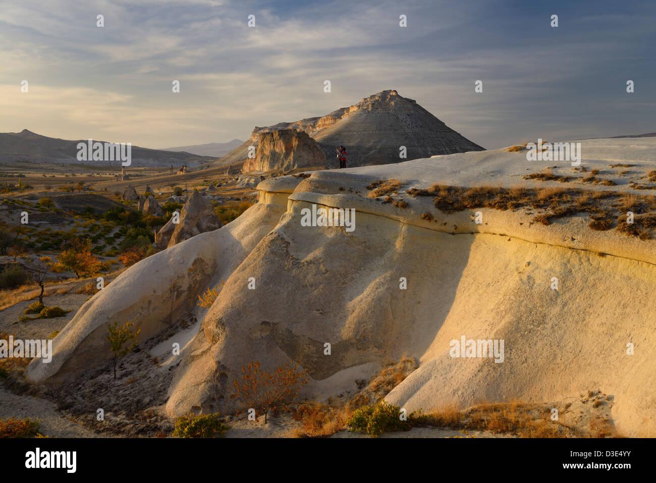 Tourists viewing landscape at Pasabag Monks Valley at sunset Generals Vineyard Cappadocia Goreme Nevsehir Turkey - Stock Image
