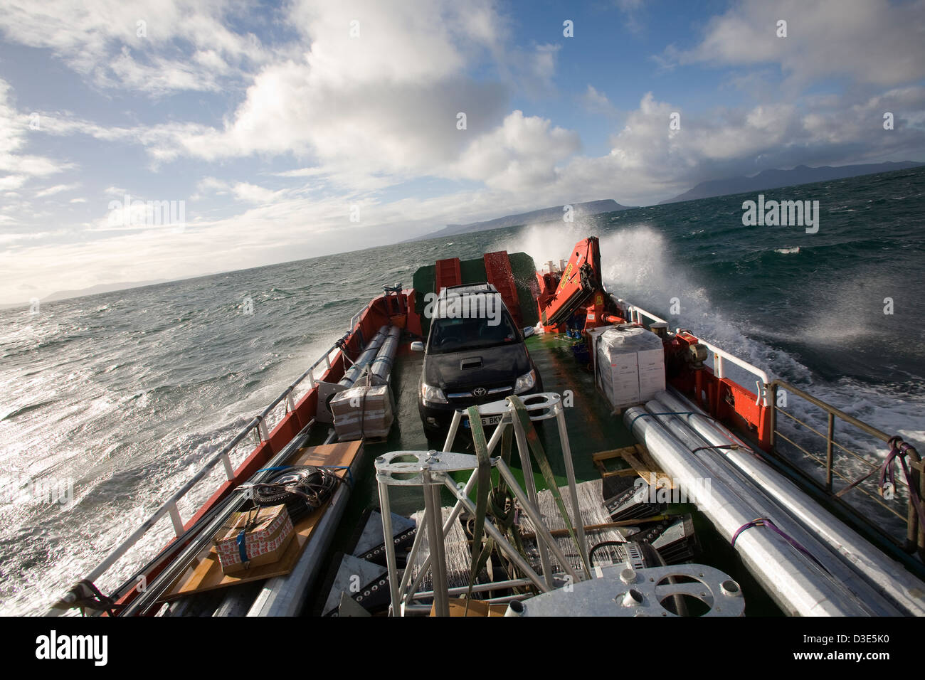 MALLAIG, SCOTLAND - 29TH OCTOBER 2007: Wind turbine parts are carried on the 'Spanish John' landing craft - Stock Image
