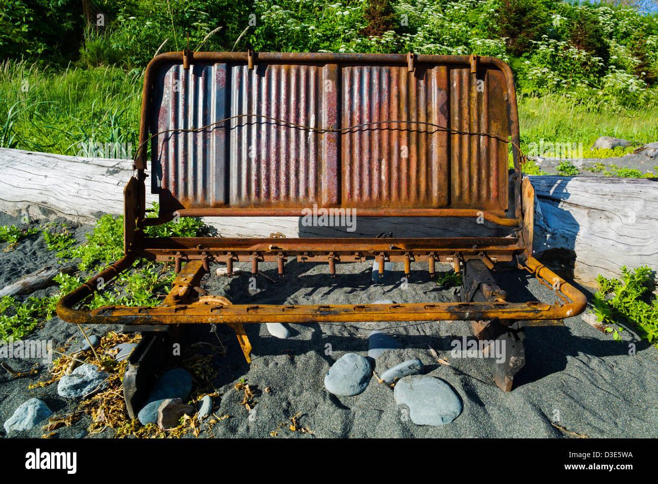 Old rusted car seat frame, Bishop Beach, Homer, Alaska, USA - Stock Image