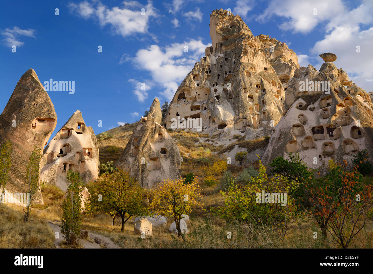 Fairy chimneys and ancient Uchisar Castle carved out of volcanic tuff Cappadocia Turkey - Stock Image