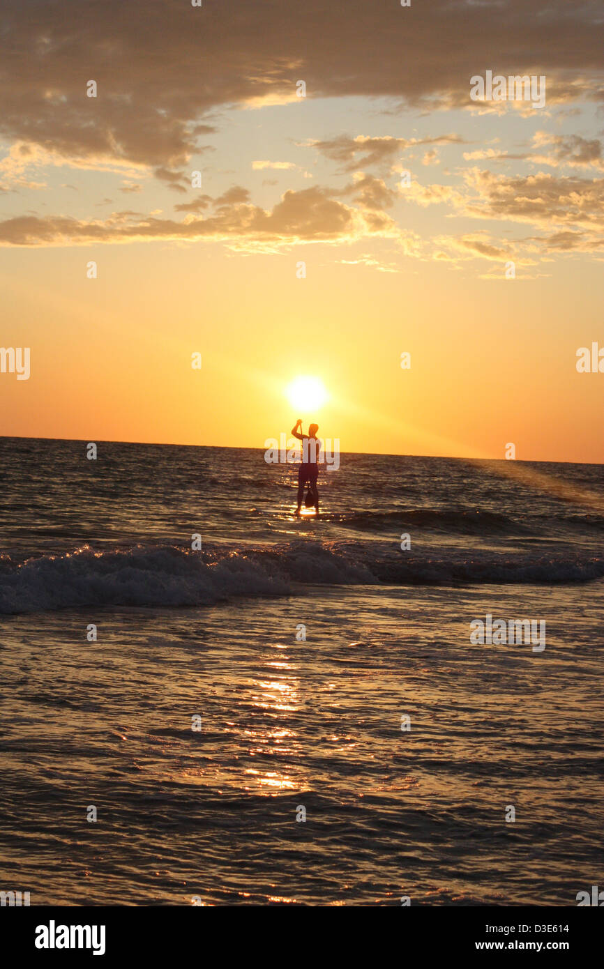 Paddle board in florida sunset - Stock Image