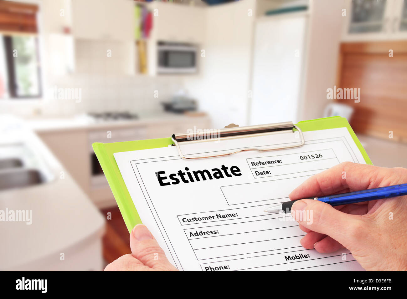 Hand Writing an Estimate for Kitchen Renovation - Stock Image