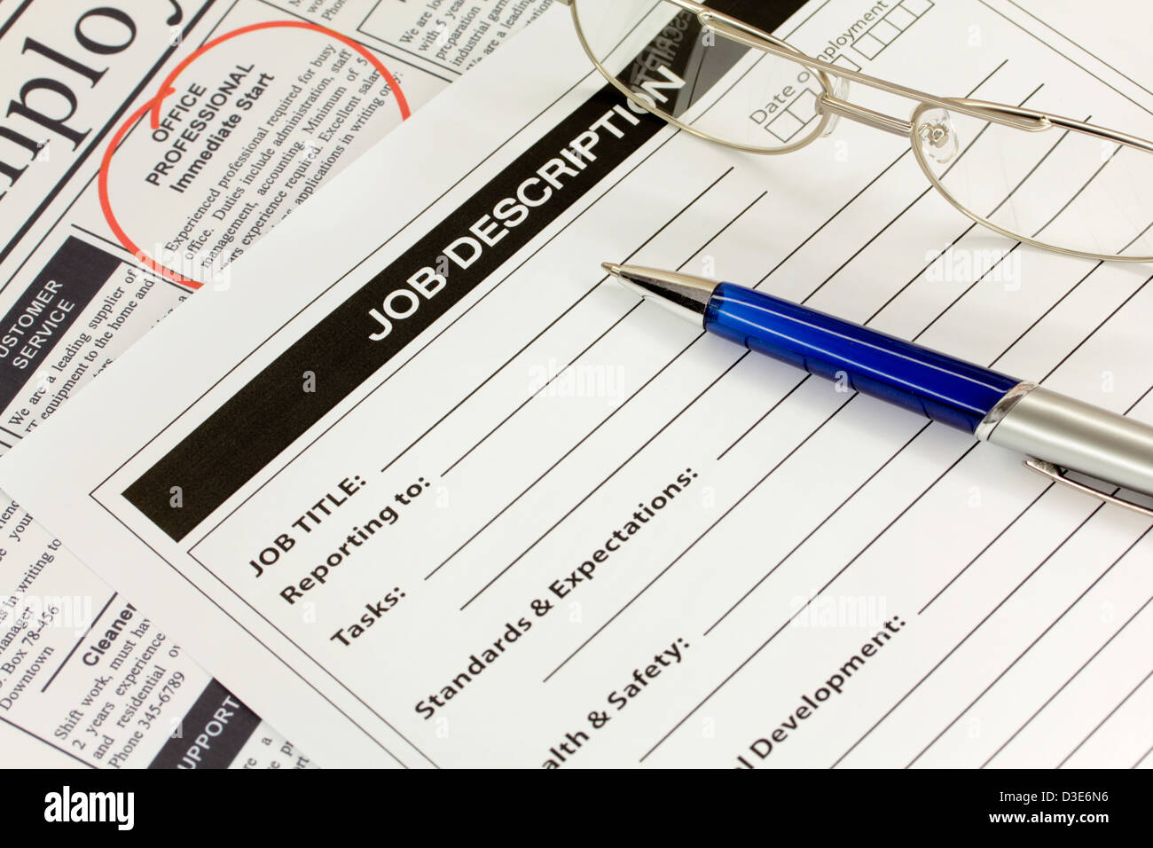 Job Description with Pen and Spectacles - Stock Image
