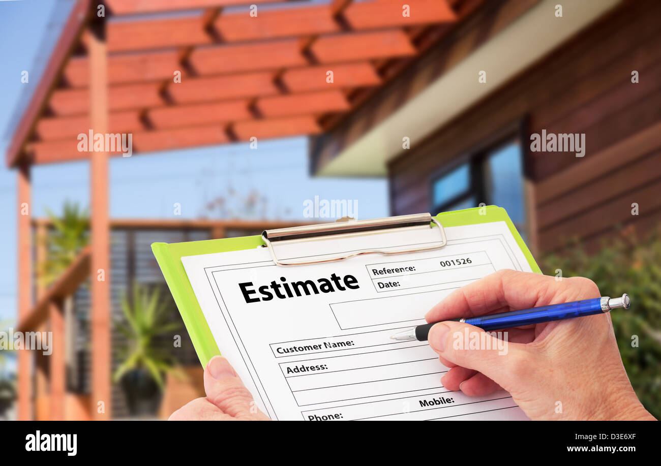 Hand Writing an Estimate for Home Building Renovation - Stock Image