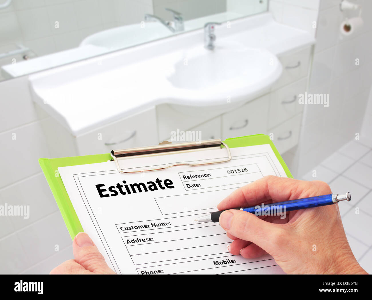 hand writing an estimate for bathroom renovation stock photo