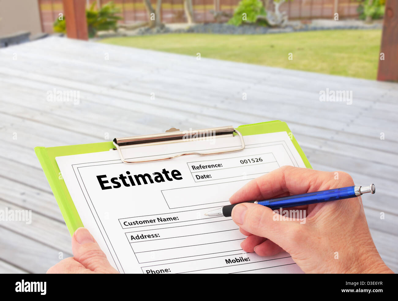 Hand Writing an Estimate for Deck Renovation - Stock Image
