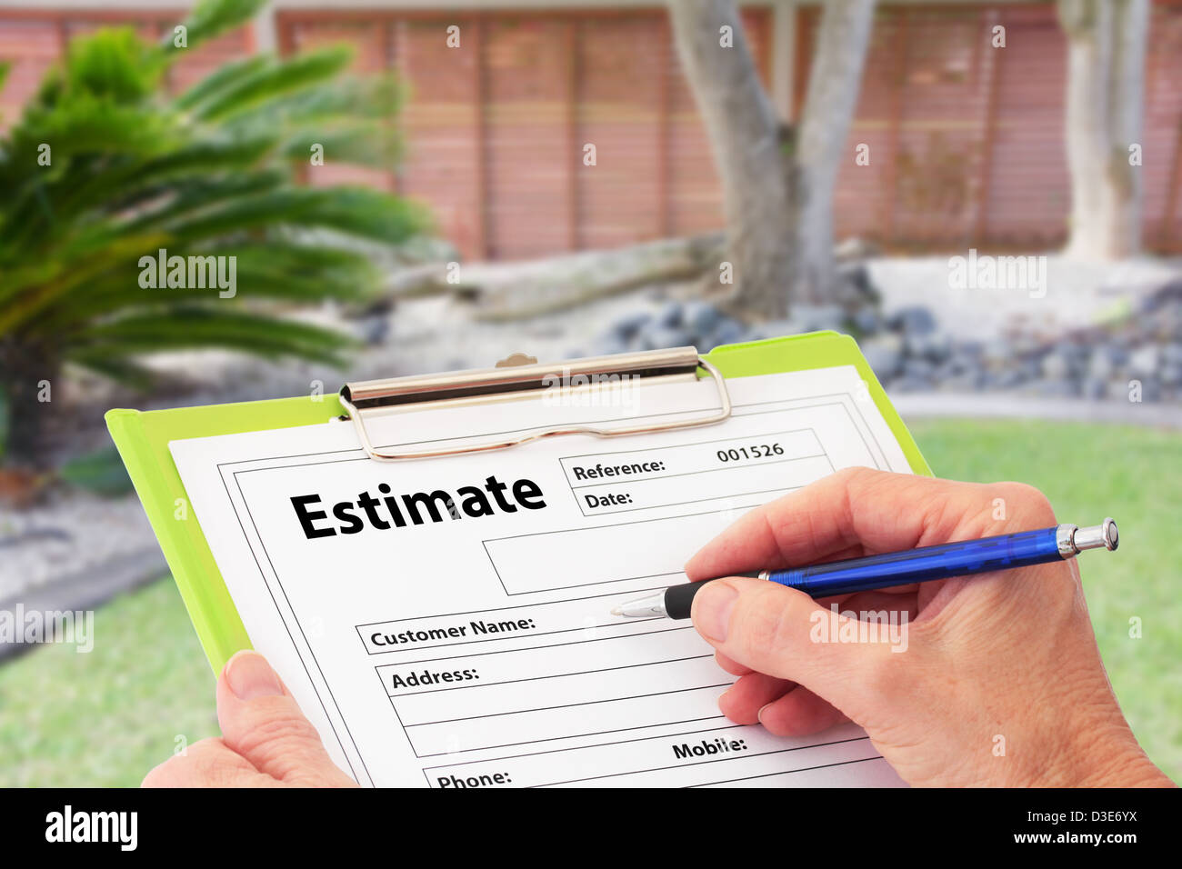 Hand Writing an Estimate for Garden Maintenance - Stock Image