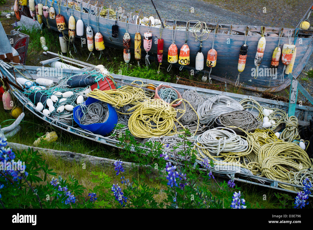 A virtual outdoor museum of fishing and boating gear adorn a property on the Homer Spit, Homer, Alaska, USA - Stock Image