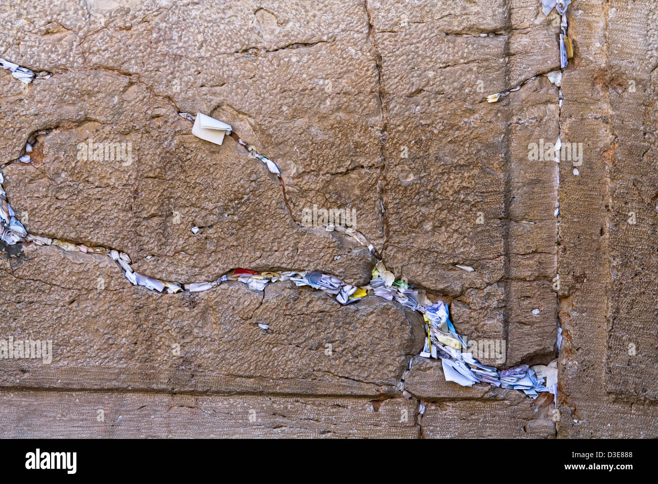 Hundreds of prayers crammed in the cracks of the Western Wall that only God knows - Stock Image