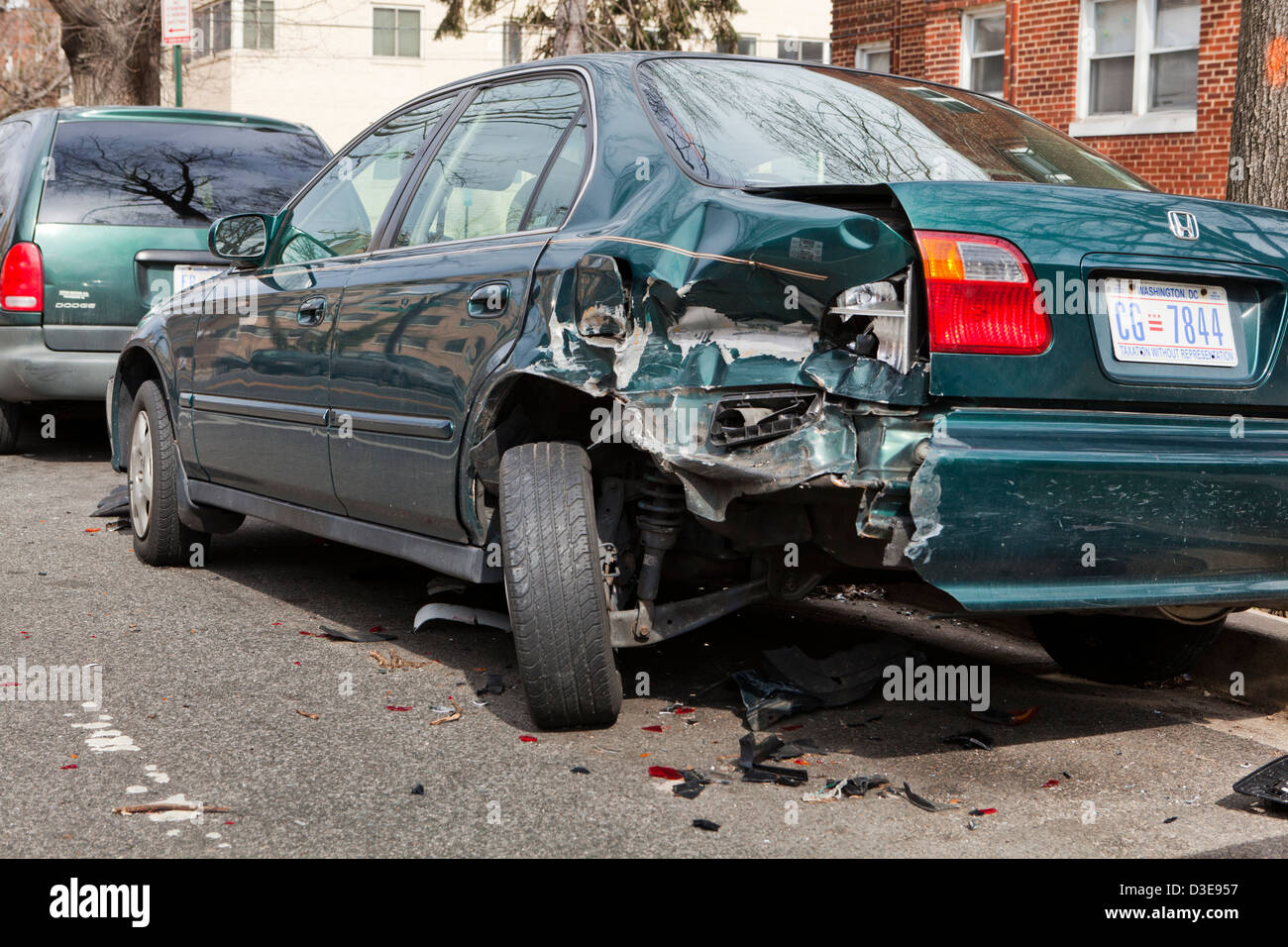 Car with rear quarter panel damage in accident - USA - Stock Image