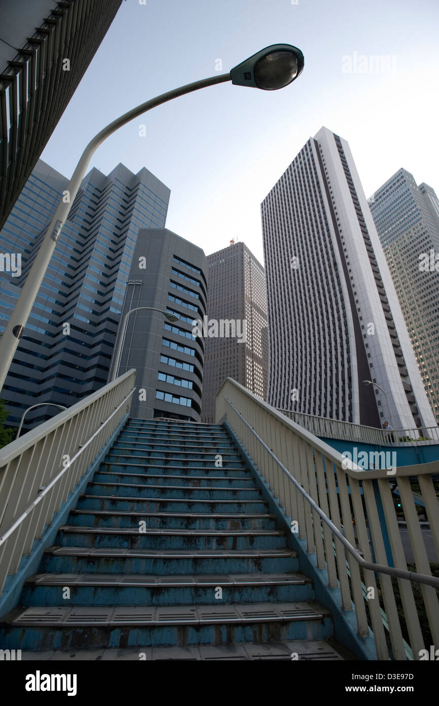 Corporate headquarter office skyscrapers fill the Tokyo skyline of the commercial business district of West Shinjuku. - Stock Image