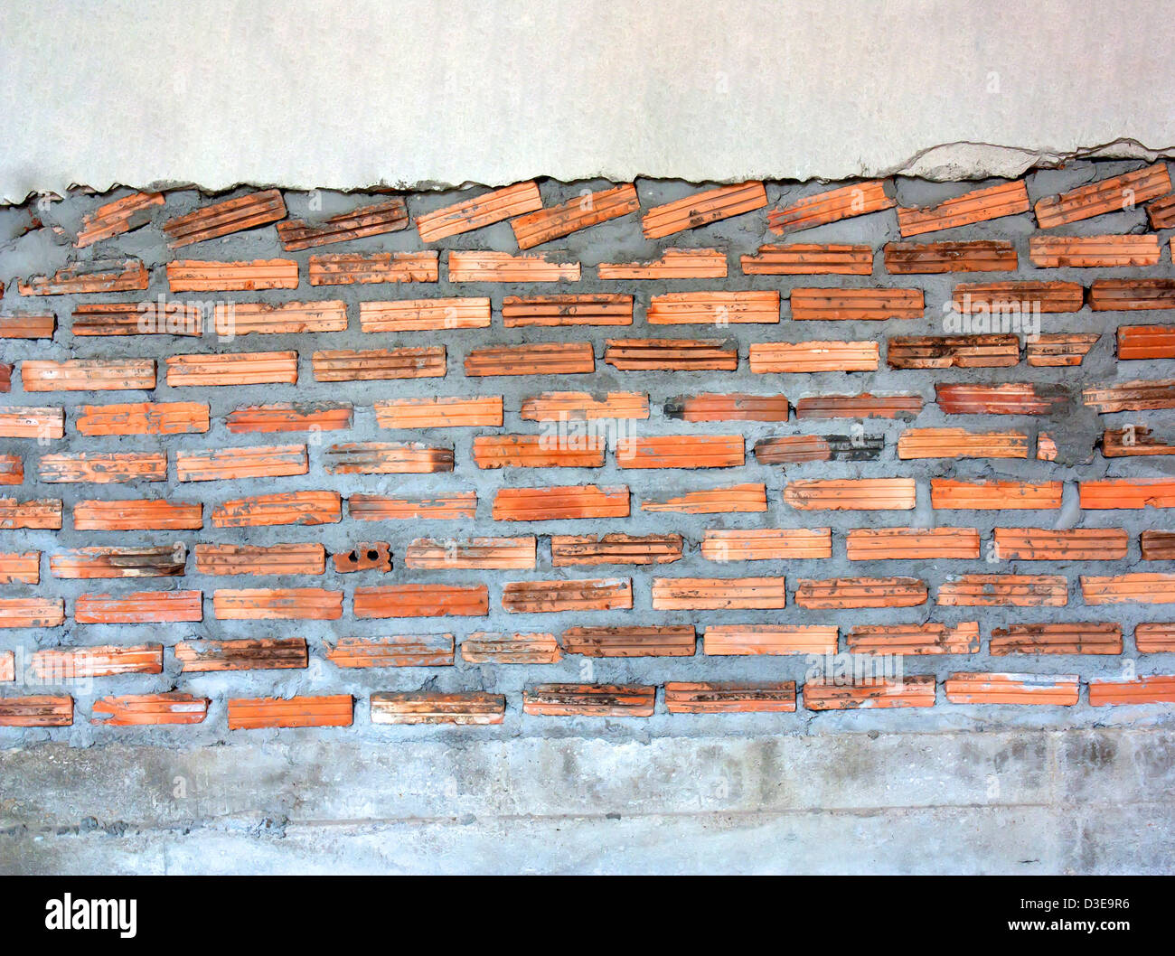Background of grunge red brick wall. Outdated. - Stock Image