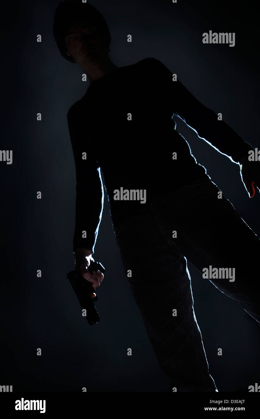 Man with gun - Stock Image