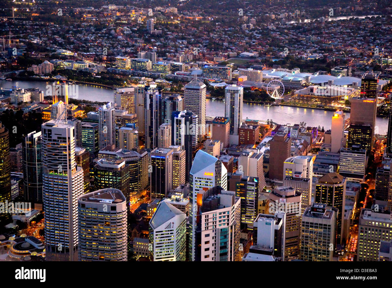 Aerial night view of Brisbane Central Business District and South Bank - Stock Image