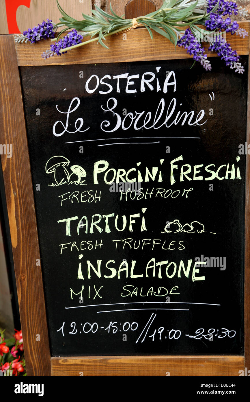 Menu blackboard outside a restaurant in Florence Italy - Stock Image
