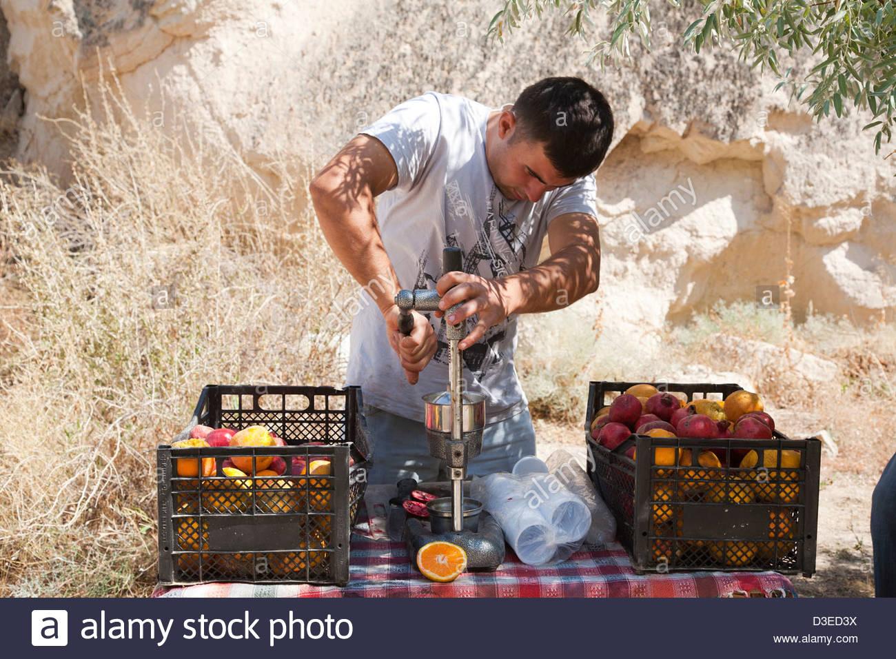 man making fruit juices,country around goreme,cappadocia,anatolia,turkey,asia - Stock Image