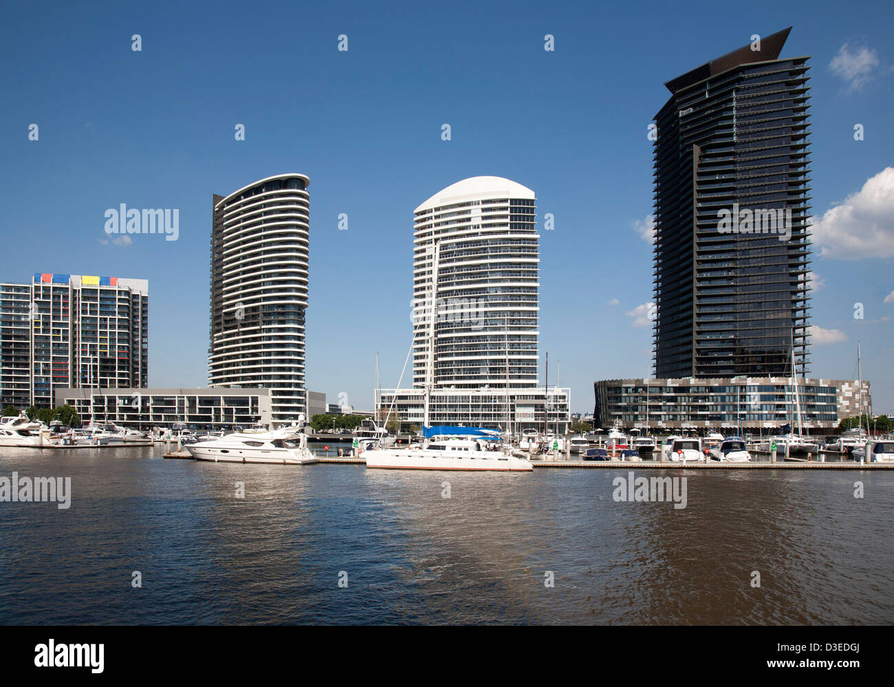 Waterfront residential apartments and marina at Victoria Harbour Docklands Melbourne Victoria Australia - Stock Image