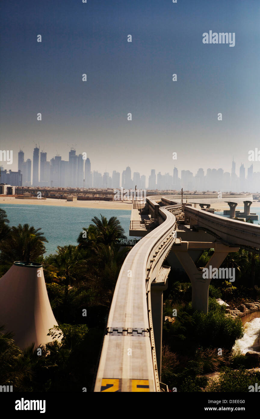 The monorail in Dubai with the Dubai skyline in the distance - Stock Image