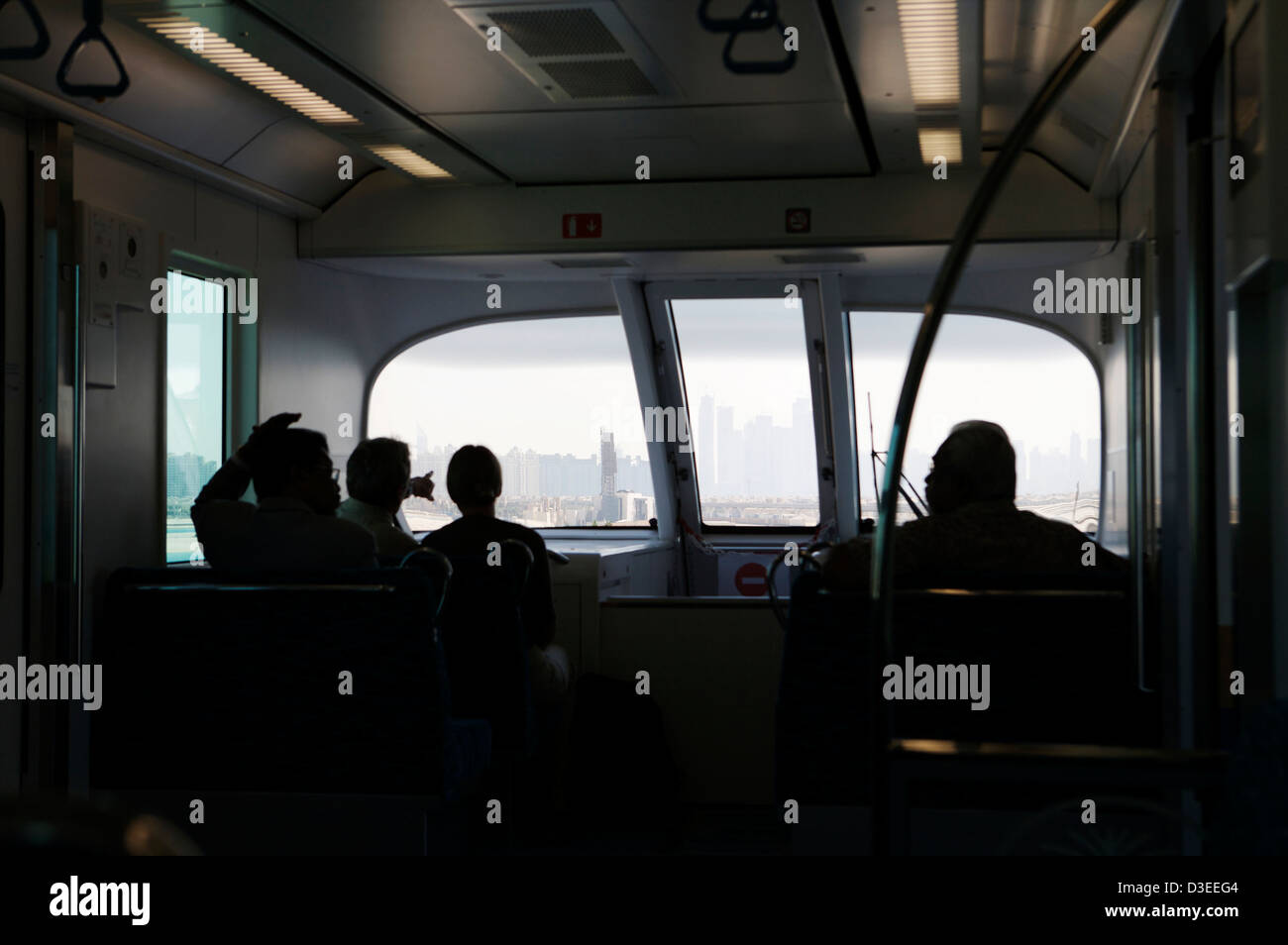Four passengers on the monorail to the Atlantis Palm hotel in Dubai, UAE - Stock Image