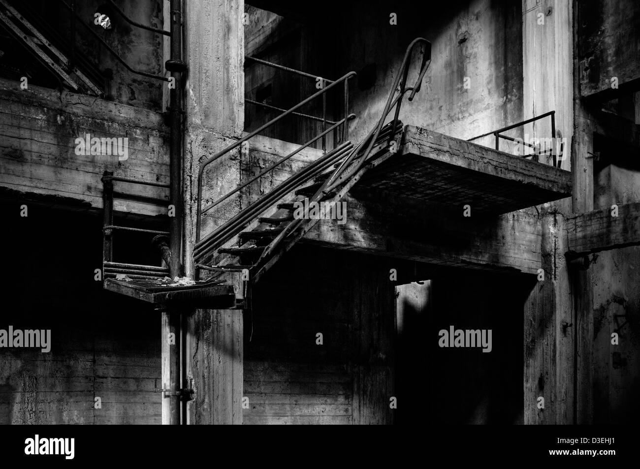 Abandoned factory. Ladder - Stock Image