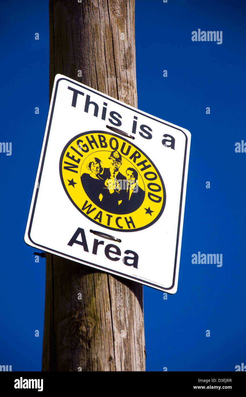Signage on post This is a Neighbourhood Watch Area - Stock Image