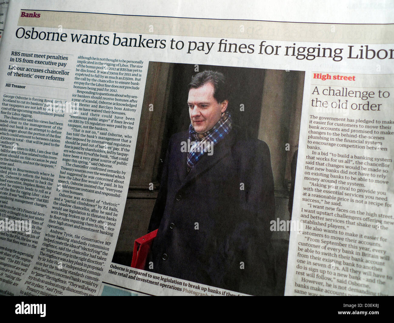 'Osborne wants bankers to pay fines for rigging Libor' headline in Guardian newspaper article London England - Stock Image