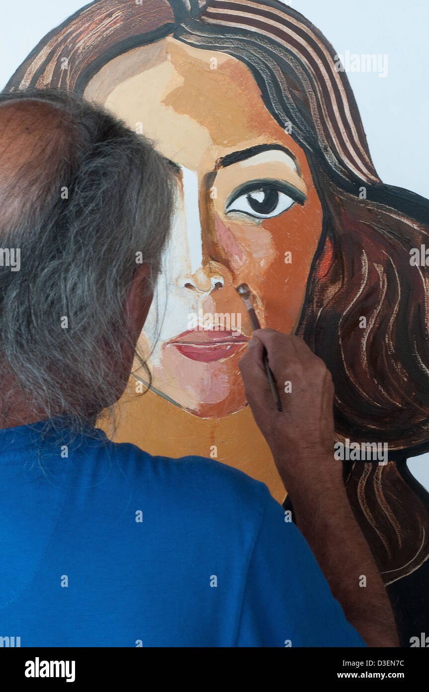 Peru, Lima, Barranco, resident arrtists. The famous painter Victor Delfin at work in his studio - Stock Image