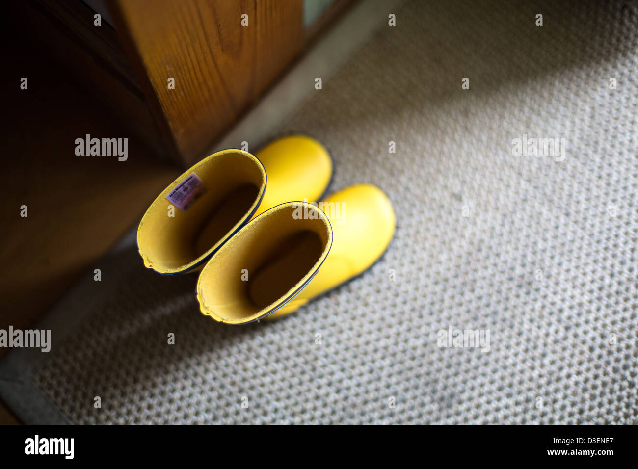 Child's Yellow Welly Boots Stock Photo