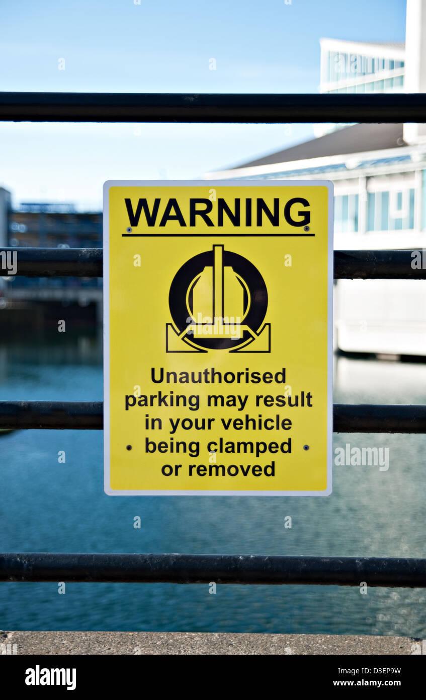A warning vehicle clamping sign, UK. - Stock Image