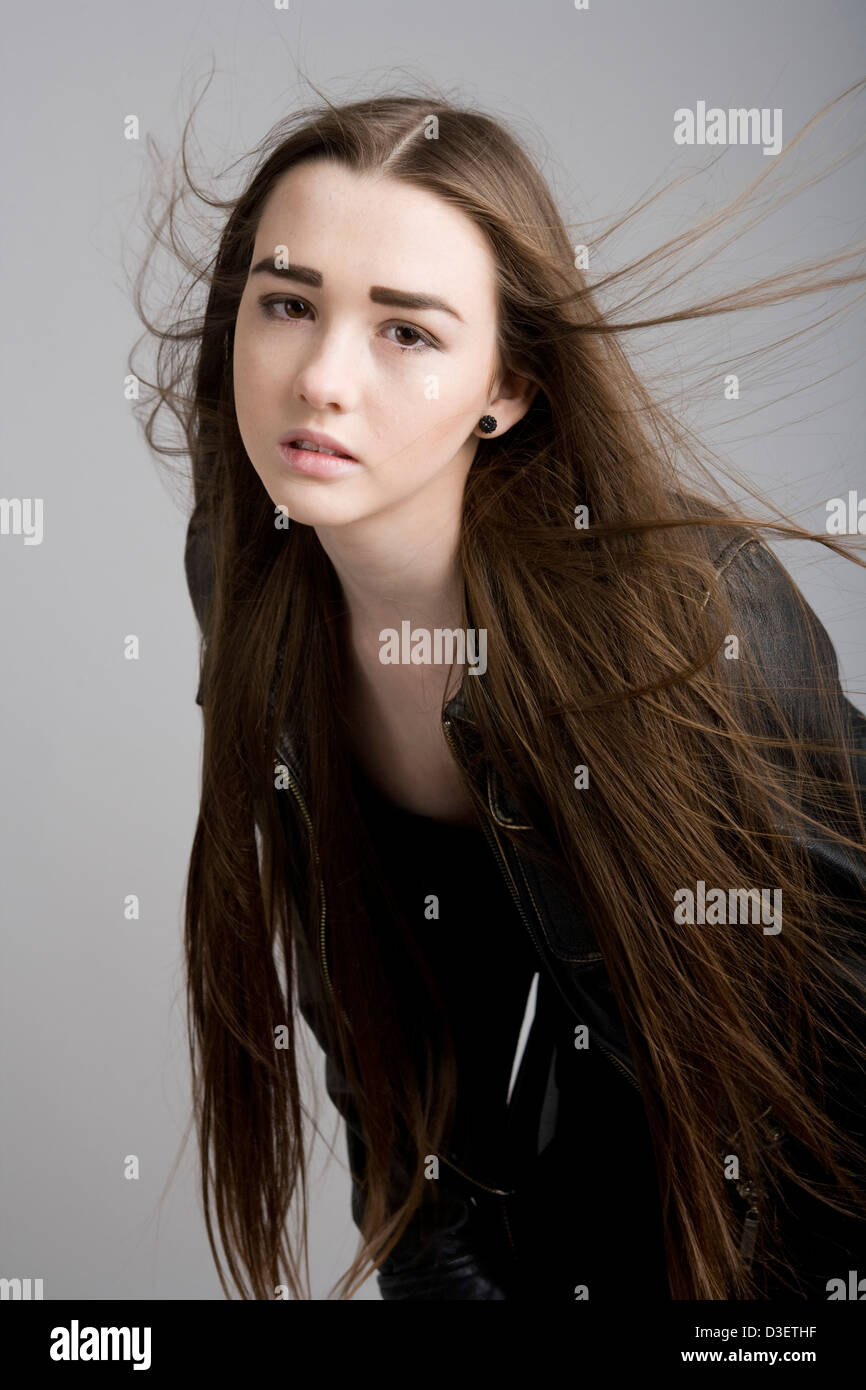 Fifteen Year Old Girl With Very Long Hair Blowing About