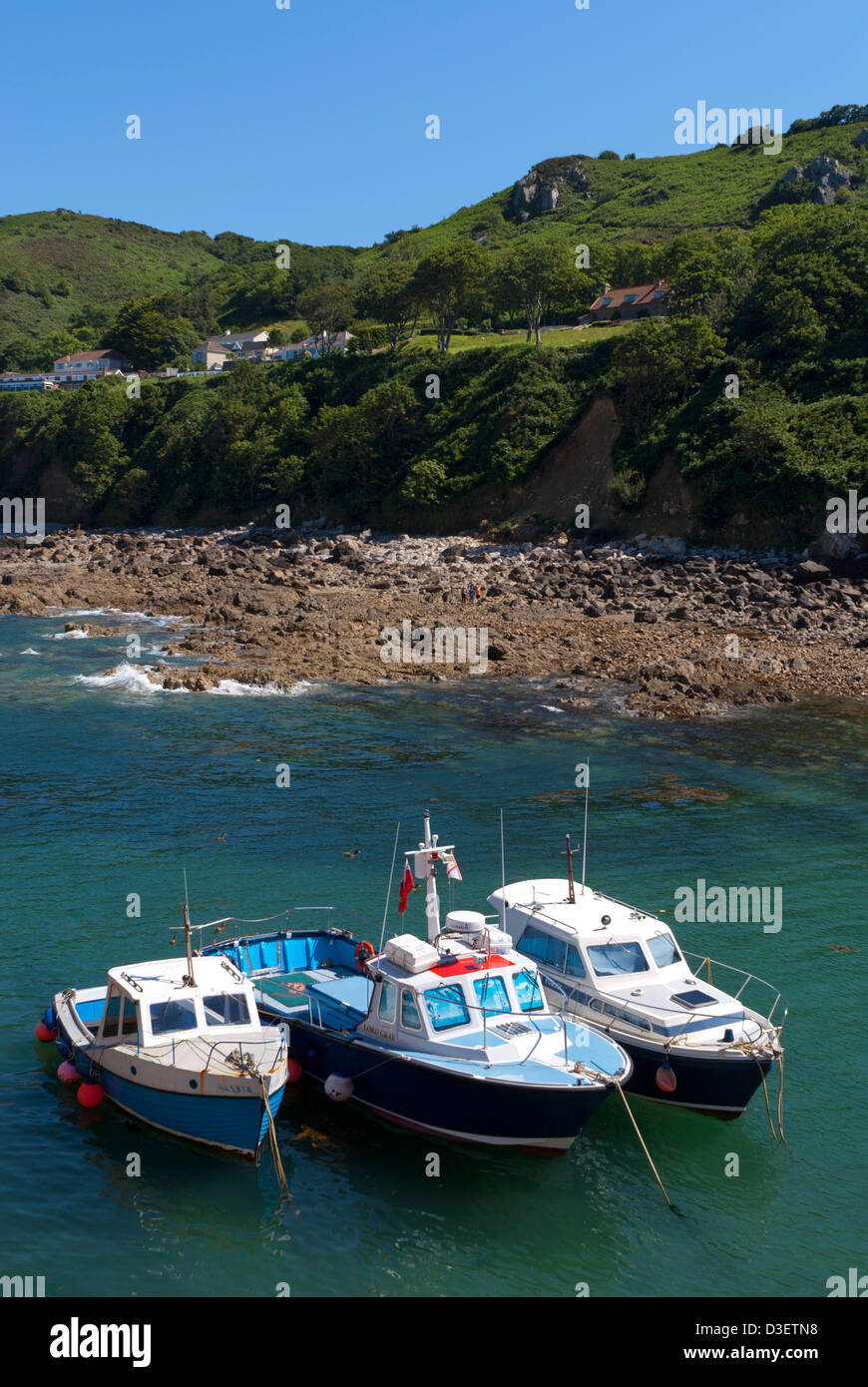 Three small fishing boats in the harbour at Bonne Nuit, Jersey, Channel Islands, UK - Stock Image