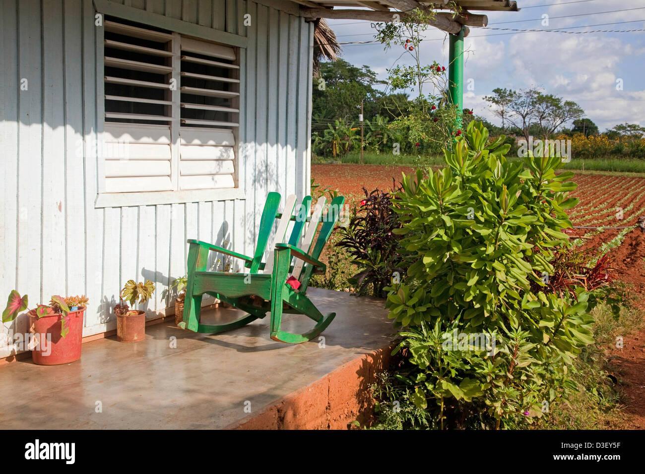 Rocking chair on porch of Cuban farmhouse in the Viñales Valley in the Sierra de los Organos, Pinar del Río, - Stock Image